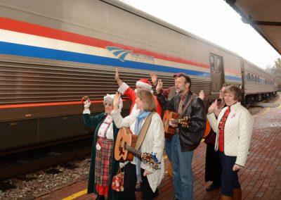 Historic-Kirkwood-Train-Station-caroloers-waving-to-train